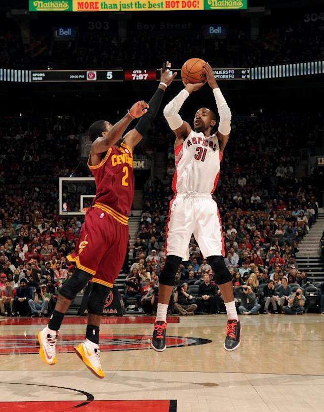 TORONTO, CANADA - February 21: Terrence Ross #31 of the Toronto Raptors shoots against the Cleveland Cavaliers on February 21, 2014 at the Air Canada Centre in Toronto, Ontario, Canada. (Photo by Ron Turenne/NBAE via Getty Images)