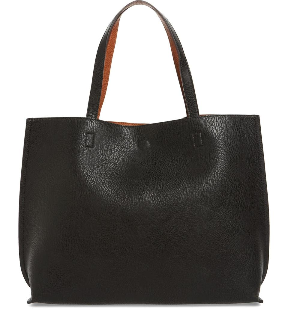 <p>This <span>Street Level Reversible Faux Leather Tote &amp; Wristlet</span> ($49) will work for the office as well as spontaneous road trips for which not much packing is required. You'll get lots of use out of it; it'll last a long time.</p>