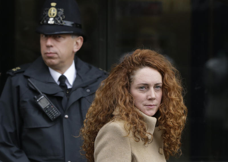 Rebekah Brooks, the former chief of News Corp.'s British operations, leaves the Old Bailey court in London London, Wednesday, Sept. 26, 2012. Brooks was in court to face charges connected to the phone hacking scandal that rocked Rupert Murdoch's News Corp. empire. (AP Photo/Lefteris Pitarakis)
