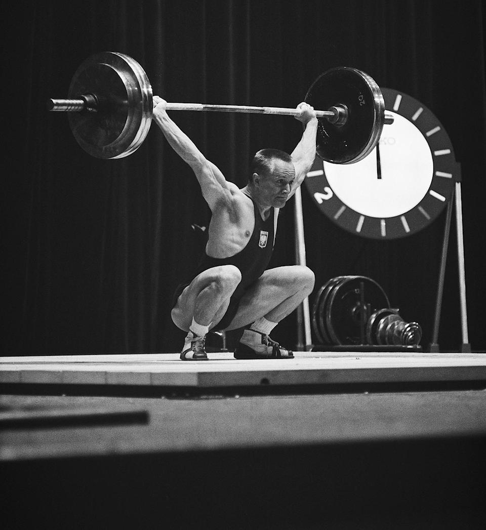 <p>Waldemar Baszanowski of Poland competes in the Men's Lightweight 67.5 kg weightlifting competition at the Shibuya Kokaido.</p>
