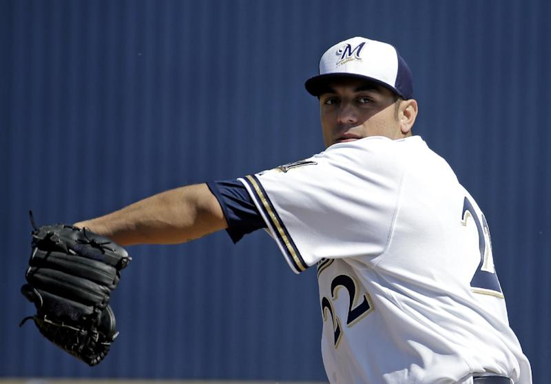 Milwaukee Brewers' Matt Garza throws before an exhibition spring training baseball game against the San Diego Padres, Friday, March 7, 2014, in Phoenix. (AP Photo/Morry Gash)