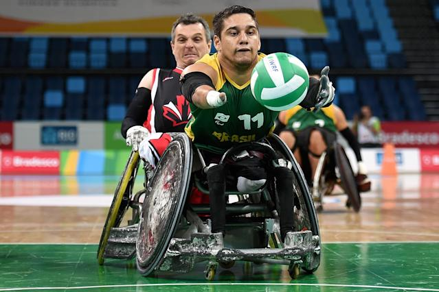 RIO DE JANEIRO, BRAZIL - FEBRUARY 26: Julio Cesar Braz of Brazil competes against David James Willsie of Canada during the International Wheelchair Rugby Championship - Aquece Rio Test Event for the Rio 2016 Paralympics match between Brazil and Canada at Olympic Park on February 26, 2016 in Rio de Janeiro, Brazil. (Photo by Buda Mendes/Getty Images)