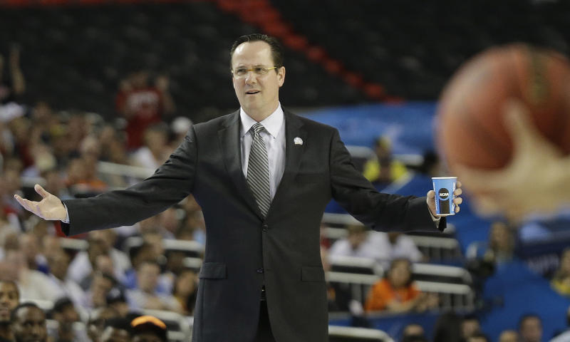 ADDS IDENTIFICATION AND CAPTION INFORMATION- Wichita State head coach Gregg Marshall reacts during the first half of the NCAA Final Four tournament college basketball semifinal game against Louisville Saturday, April 6, 2013, in Atlanta. (AP Photo/David J. Phillip)