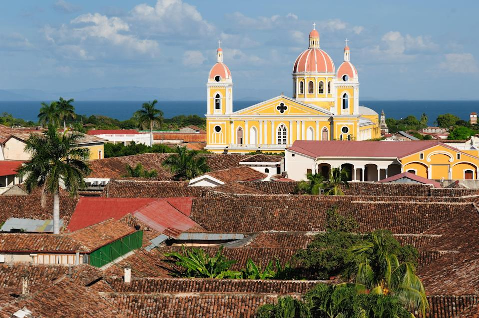 """<p>Along with its volcanoes, freshwater lakes, and rainforests brimming with wildlife, Nicaragua lures foreign retirees with a bevy of financial incentives. These include the ability for retirees to import up to $20,000 of household goods (such as furniture, clothing, etc.) and a car up to $25,000 in value, duty-free. Another motivator: All foreign income is tax-free.</p> <p>The advantages of Nicaragua's <a href=""""https://ni.usembassy.gov/u-s-citizen-services/citizenship-services/immigration-laws/"""" rel=""""nofollow noopener"""" target=""""_blank"""" data-ylk=""""slk:Pensionado Residency program"""" class=""""link rapid-noclick-resp"""">Pensionado Residency program</a>, which is renewable after five years, don't end there. Once you receive a residency card, which grants retiree status (it takes up to 6 months once you've submitted your application), you can open a local bank account, use credit to shop, and even get a local phone plan. For those looking to build a home, retirees can also purchase up to $50,000 of construction materials tax-free.</p> <p><strong>Requirements:</strong> Foreign nationals can retire in Nicaragua at the age of 45 as long as they have a permanent passive income of $600 per month (plus $150 per month for each dependent). You're also required to spend at least 6 months (which can be non-consecutive) per year within the country to keep residency status.</p>"""
