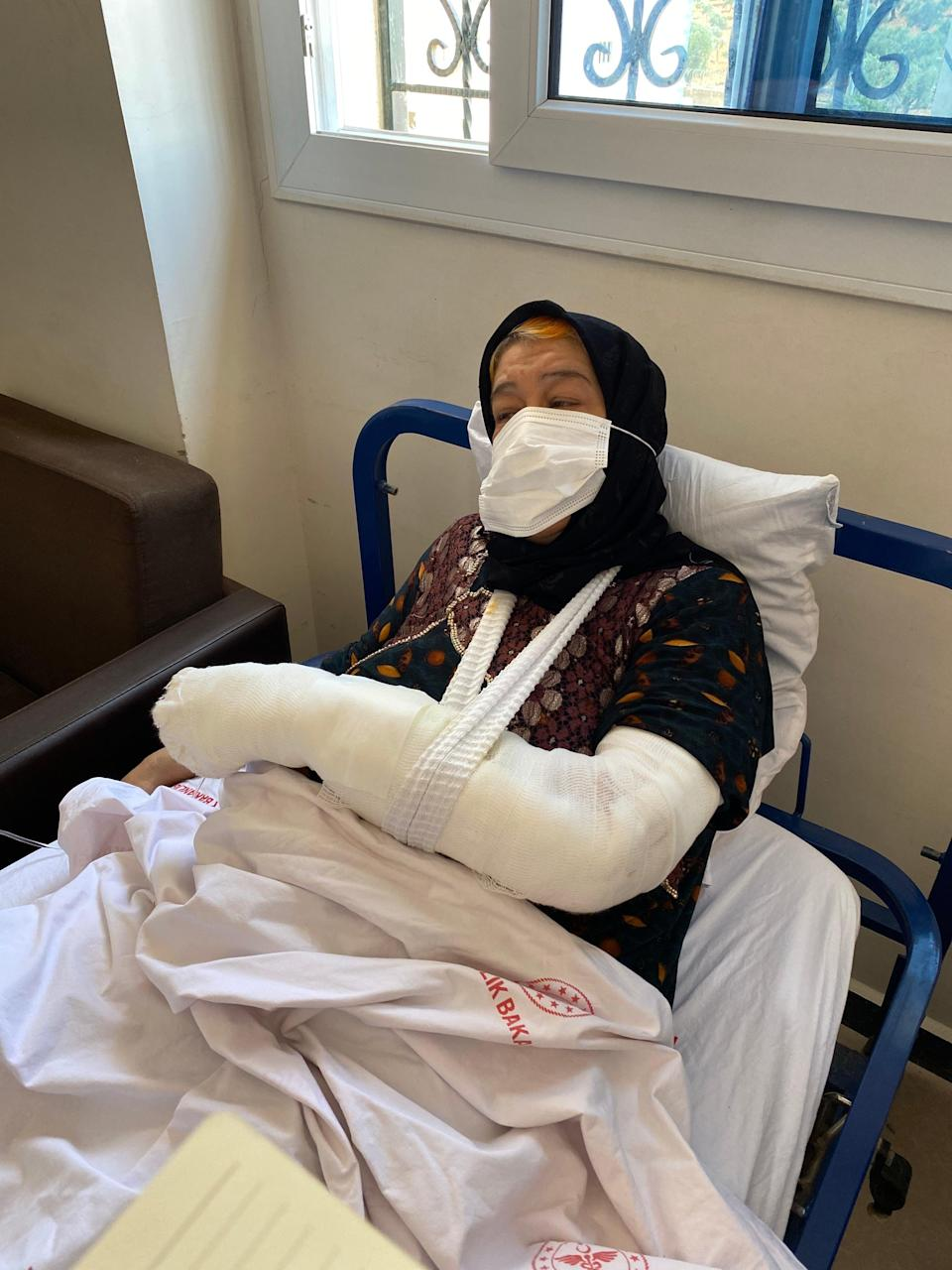 Daid al Kamal, 60,  went to the hospital to recover from shock after her neighbourhood was struck by a barrage of rockets in Afrin, northwest Syria. Then rockets hit the hospital. She recovers at another hospital (Borzou Daragahi)