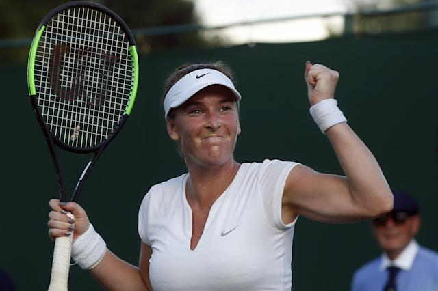 Madison Brengle of the United States celebrates after winning her Women's Singles Match against Richel Hogenkamp of the Netherlands, on the opening day at the Wimbledon Tennis Championships in London Monday, July 3, 2017. (AP Photo/Alastair Grant)