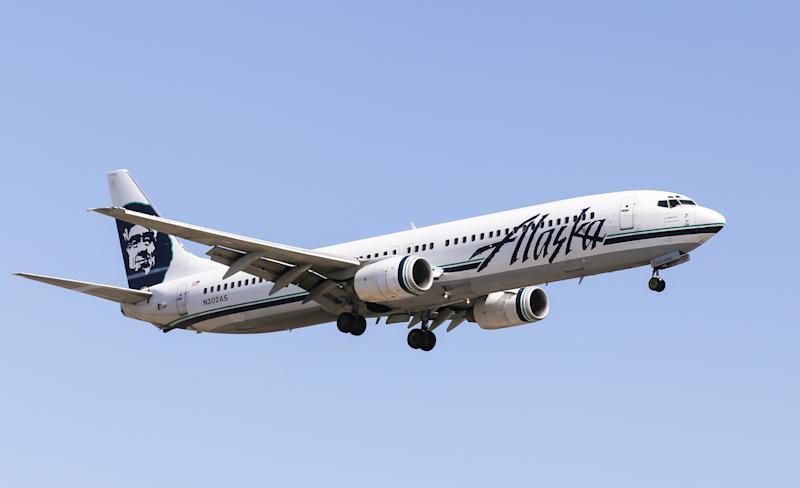 A gay man has accused Alaska Airlines of giving a straight couple