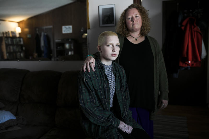 Aidyn Sucec and his mother, Laura Sucec, sit in their home in Brownsburg, Indiana on Nov. 11, 2019.   Maddie McGarvey for TIME