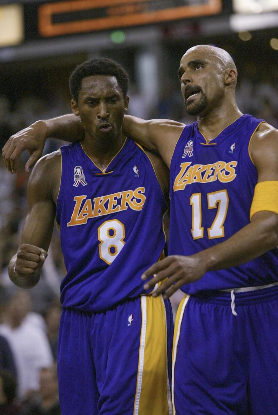 Kobe Bryant and Rick Fox embrace during a break in a game against the Sacramento Kings in 2002.