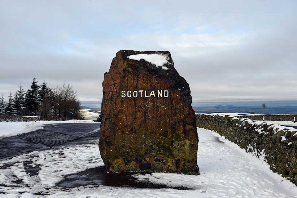 Snow blankets the ground at the border between England and Scotland, near Jedburgh. (AFP via Getty Images)
