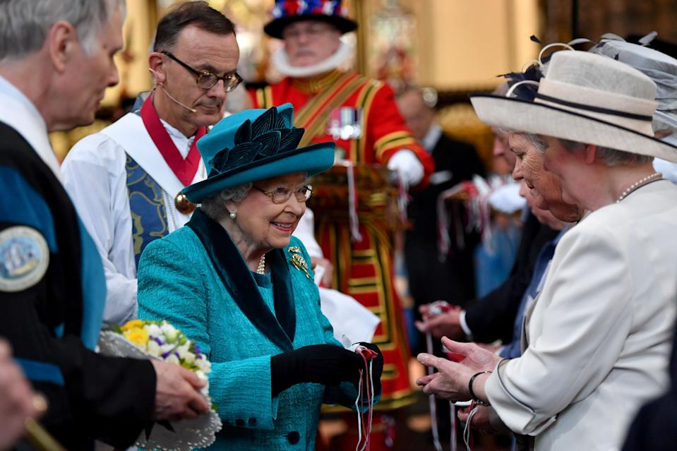 Britain's Queen Elizabeth II hands out Maundy money during the Royal Maundy service at Leicester Cathedral on April 13, 2017 in Leicester. / AFP PHOTO / POOL / Anthony Devlin        (Photo credit should read ANTHONY DEVLIN/AFP via Getty Images)