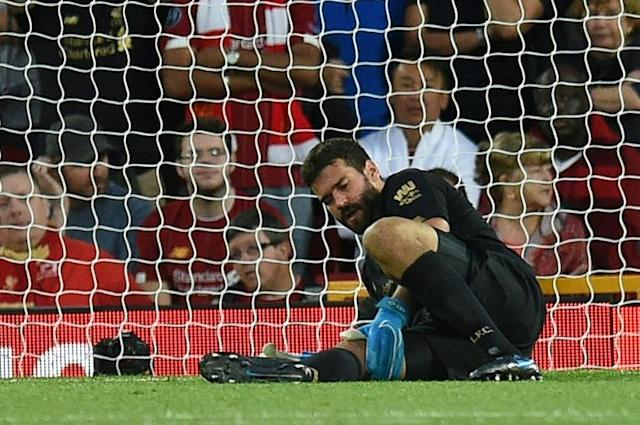 Big miss: Alisson Becker could be out for up to two months with a calf injury (AFP Photo/Oli SCARFF )