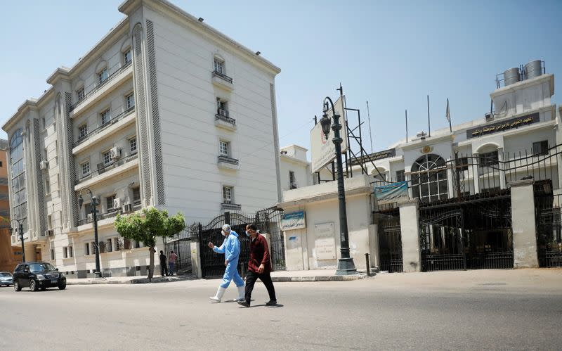 Members of medical team walk in front of the Institute of Research for Tropical Medicine amid concerns about the spread of the coronavirus disease (COVID-19), in Cairo
