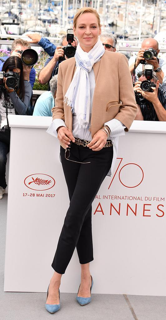 <p>Even her more casual looks have been killer. The mom of three wore cropped pants, a jacket, and a cool scarf as she did her fave crossed-leg pose for the shutterbugs at the Jury Un Certain Regard photo call on May 18. (Photo: George Pimentel/WireImage) </p>