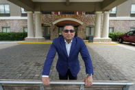 Vimal Patel president of Q Hotels, poses for a photograph at his Holiday Inn Express Hotel in LaPlace, La., Wednesday, June 23, 2021. (AP Photo/Gerald Herbert)