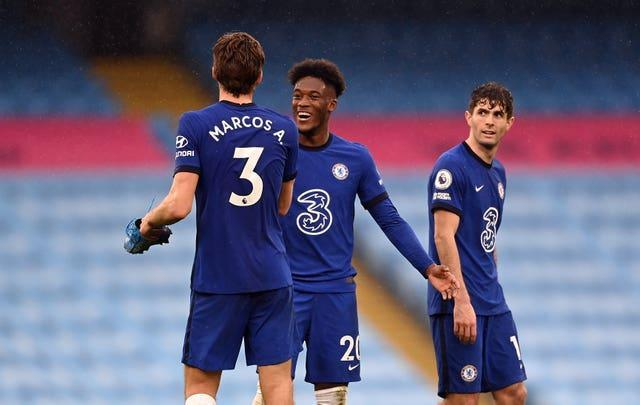 Marcos Alonso (left) celebrates his winner