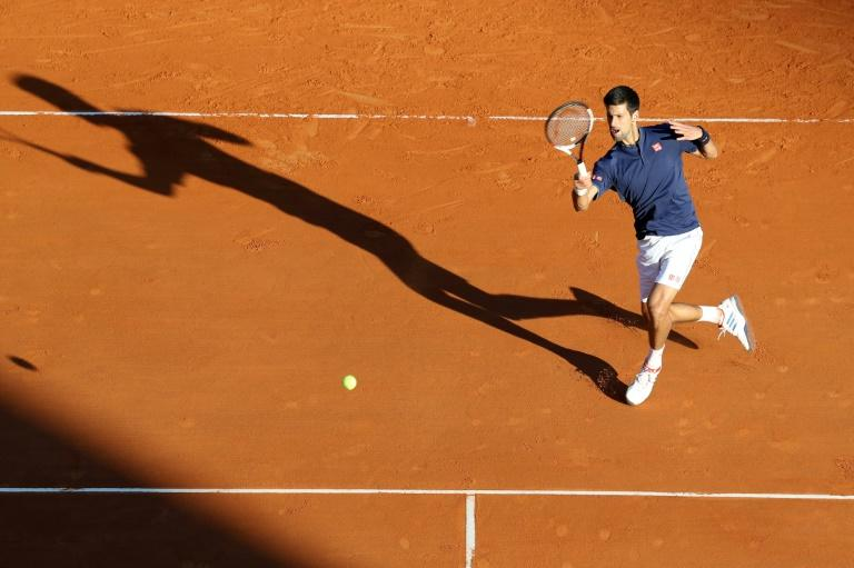 Serbian player Novak Djokovic hits a return to Spain's Pablo Carreno Busta during their Monte-Carlo ATP Masters Series Tournament tennis match, on April 20, 2017 in Monaco