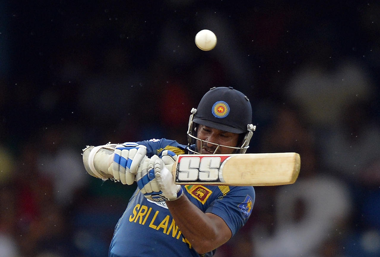 Sri Lankan cricketer Kumar Sangakkara plays a shot during the fifth match of the Tri-Nation series between Sri Lanka and West Indies at the Queen's Park Oval in Port of Spain on July 7, 2013. West Indies won the toss and elected to field. AFP PHOTO/Jewel Samad