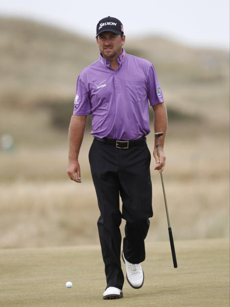 Graeme McDowell of Northern Ireland walks onto the 16th green during a practice round ahead of the British Open Golf Championship at Muirfield, Scotland, Wednesday July 17, 2013. (AP Photo/Jon Super)