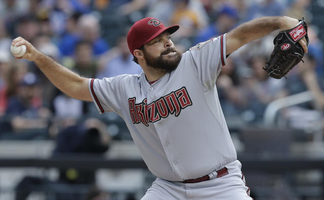 Arizona Diamondbacks starting pitcher Josh Collmenter delivers against the New York Mets during the first inning of a baseball game, Saturday, May 24, 2014, in New York. (AP Photo/Julie Jacobson)