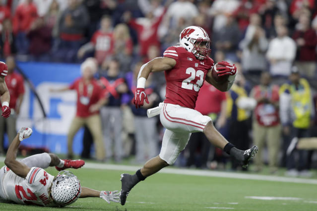 Wisconsin running back Jonathan Taylor has 6,080 rushing yards in three seasons in Madison. (AP Photo/Michael Conroy, File)