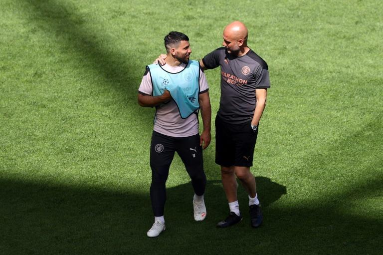 Manchester City's Sergio Aguero with coach Pep Guardiola at a training session on Friday