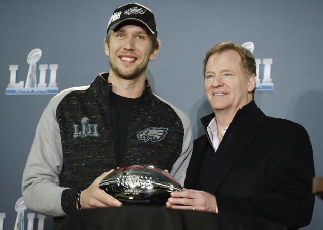NFL commissioner Roger Goodell and Eagles quarterback Nick Foles pose with the QB's MVP trophy on Monday. (AP)