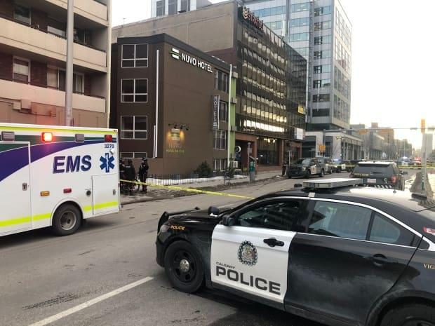 Calgary police and EMS remained on the scene near the Nuvo Hotel in the Beltline around 5 p.m. Wednesday after a shooting. (Meghan Grant/CBC - image credit)