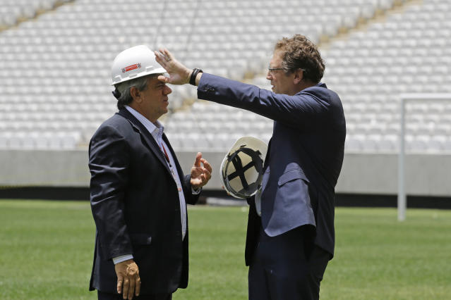 Antonio Gavioli, director of Odebrecht, left, talks with Jerome Valcke, Secretary General of FIFA during an inspection tour of Arena de Sao Paulo stadium, in Sao Paulo, Brazil, Monday, Jan. 20, 2014. Members of FIFA and the 2014 World Cup Local Organizing Committee started an inspection tour of stadiums in host cities across Brazil. (AP Photo/Nelson Antoine)