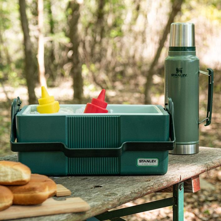 """Timeless design and durable construction will carry lunch for the long haul. <br> $75, Magnolia. <a href=""""https://shop.magnolia.com/collections/fathers-day/products/heritage-cooler-bottle-set"""" rel=""""nofollow noopener"""" target=""""_blank"""" data-ylk=""""slk:Buy Now"""" class=""""link rapid-noclick-resp"""">Buy Now</a><br>"""