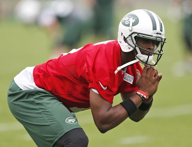 New York Jets quarterback Geno Smith stretches during an NFL football organized team activity, Wednesday, May 28, 2014, in Florham Park, N.J. (AP Photo/Julio Cortez)