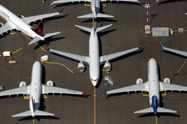 Boeing reported a sharp drop in third-quarter earnings due to the 737 MAX grounding, but said it still expects regulatory approval this year to return the plane to service