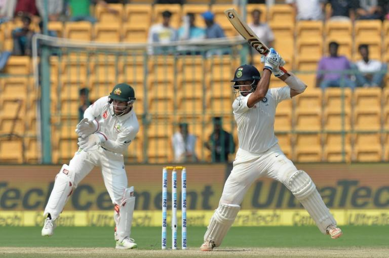 India batsman Cheteshwar Pujara plays a shot as Australia wicket keeper Matthew Wade looks on during third day of the second Test at The M. Chinnaswamy Stadium in Bangalore on March 6, 2017