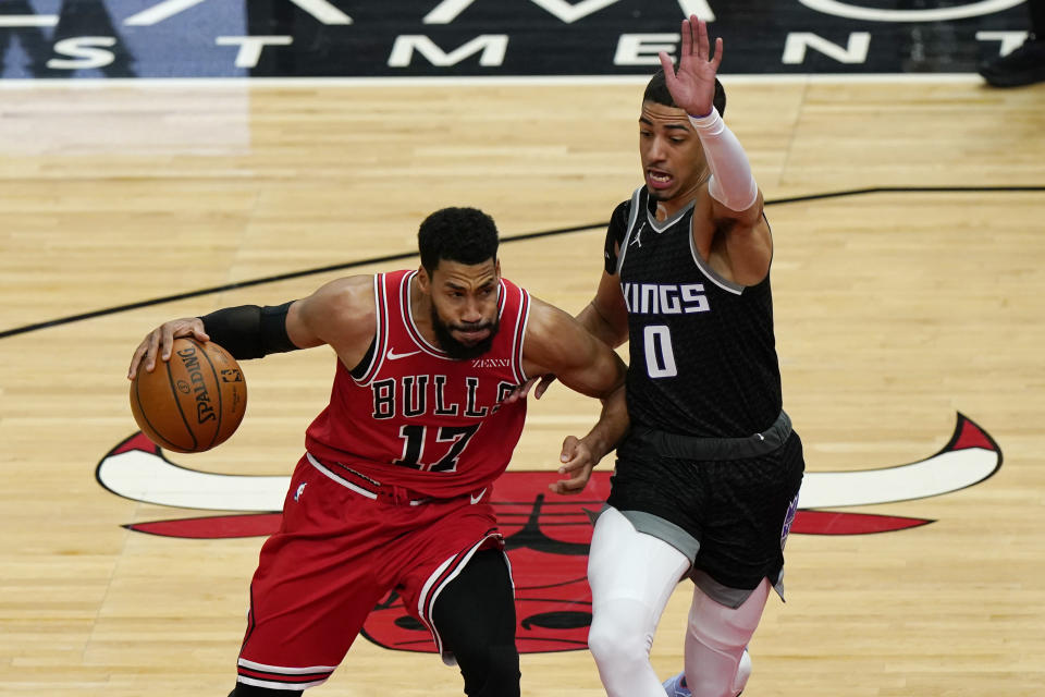 Chicago Bulls guard Garrett Temple, left, drives against Sacramento Kings guard Tyrese Haliburton during the first half of an NBA basketball game in Chicago, Saturday, Feb. 20, 2021. (AP Photo/Nam Y. Huh)