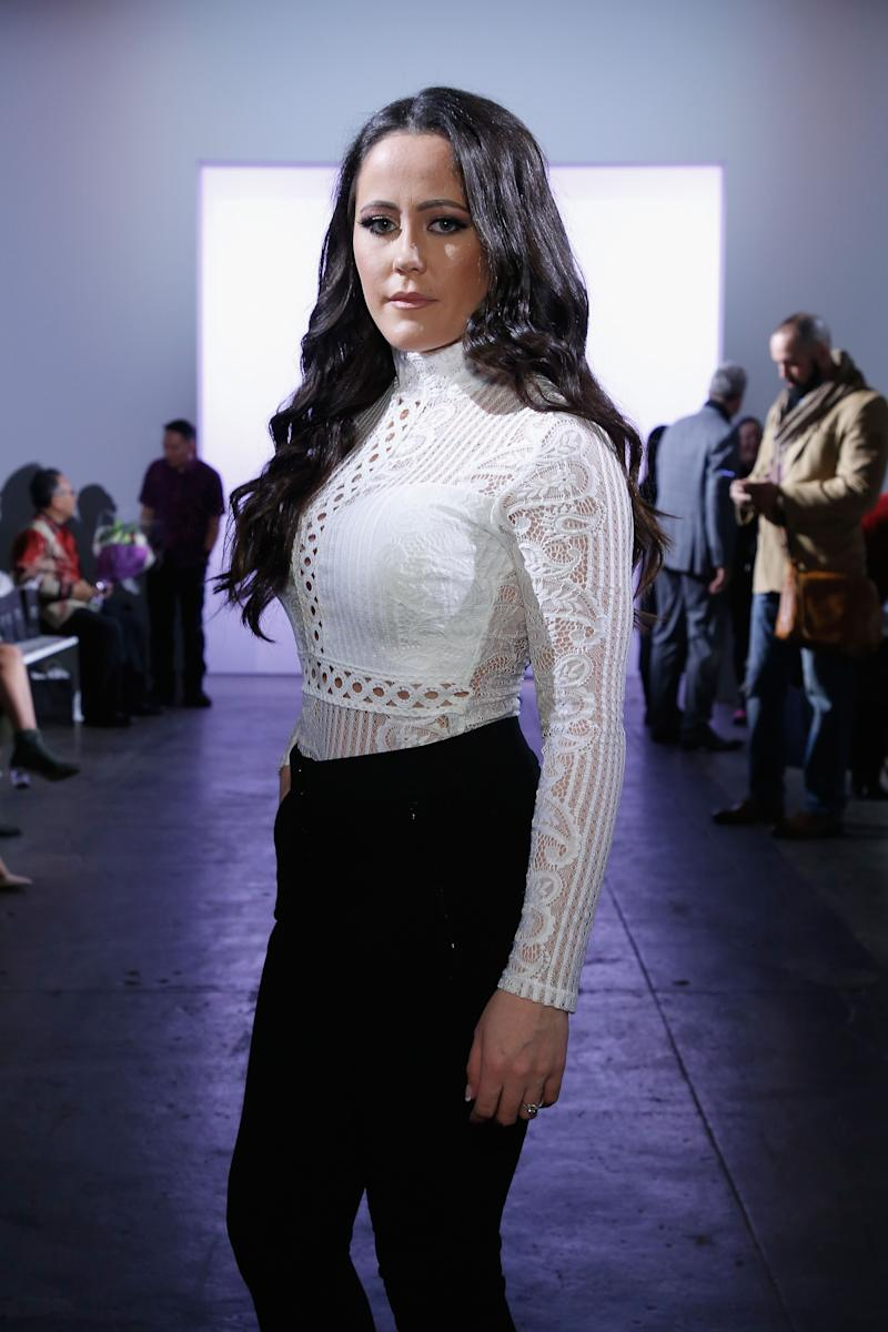 Jenelle Evans poses in dark pants at an event