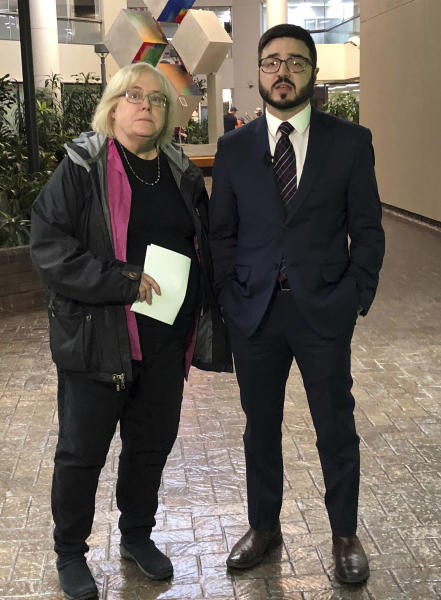 Deitra Ennis, left, and Ryan Stuart, attorneys with the city of Anchorage, Alaska, talk to reporters after a hearing in federal court Friday, Jan. 11, 2019. They represent the city in a federal lawsuit filed by a faith-based shelter over a local requirement that it accept transgender women. Alliance Defending Freedom, a conservative Christian law firm, is seeking a temporary injunction to stop the city from applying its gender identity law to the Hope Center shelter. (AP Photo/Rachel D'Oro)