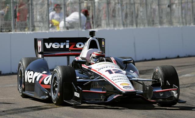 Will Power, of Australia, drives into Turn 10 during the IndyCar Grand Prix of St. Petersburg auto race, Sunday, March 30, 2014, in St. Petersburg, Fla. Power won the race. (AP Photo/Chris O'Meara)