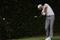 Dustin Johnson drives on the second tee during the third round of the Masters golf tournament Saturday, Nov. 14, 2020, in Augusta, Ga. (AP Photo/Charlie Riedel)