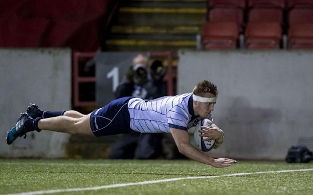 <span>Matt Fagerson dives over for a try</span> <span>Credit: REX FEATURES </span>