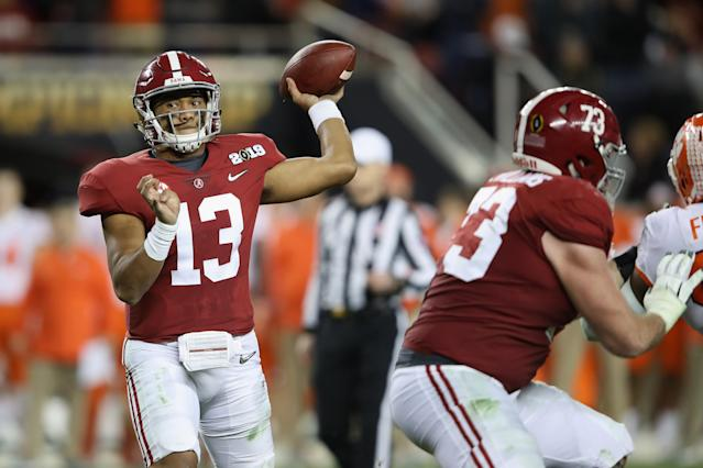 Tua Tagovailoa (13) of the Alabama Crimson Tide attempts a pass against the Clemson Tigers in the CFP title game on Jan. 7. (Getty)