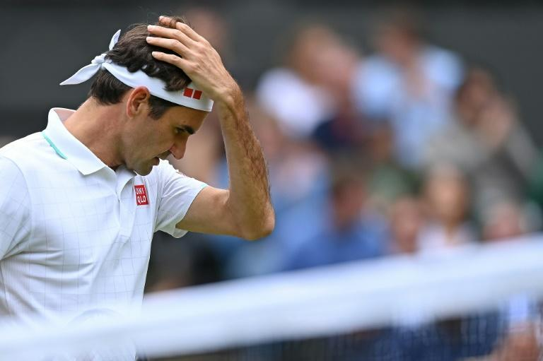 All over: Roger Federer reacts to defeat against Poland's Hubert Hurkacz