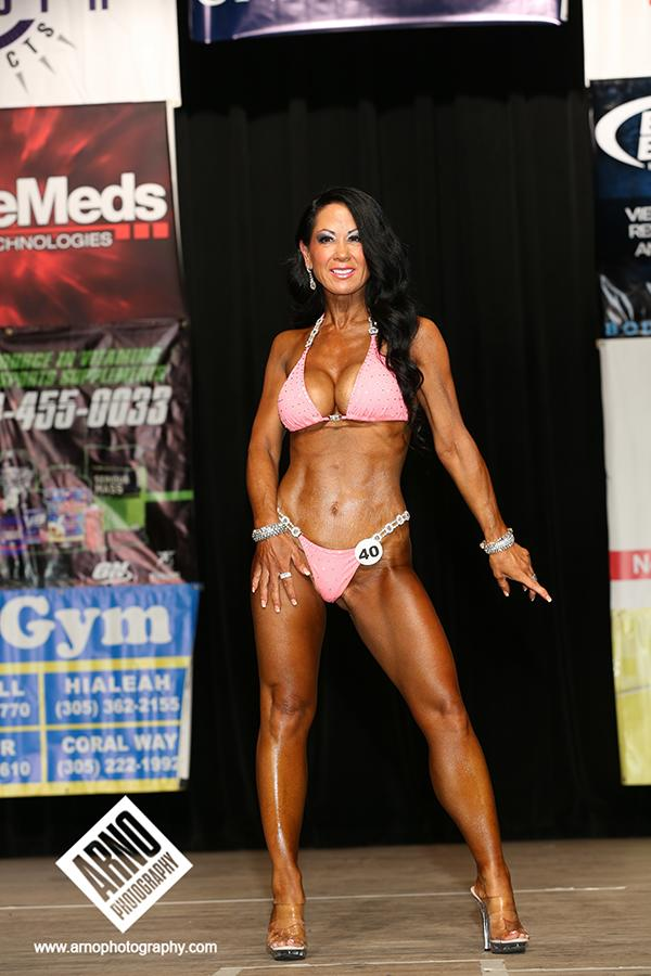 "<div class=""caption-credit""> Photo by: Arno Photography</div><div class=""caption-title""></div>Teresa Vaught is the second runner-up in the over 50 bikini division. ""We have onsite tanning facilities so the women can tan before the show,"" says Potter. ""Color gives the skin a healthy glow."" <br>"