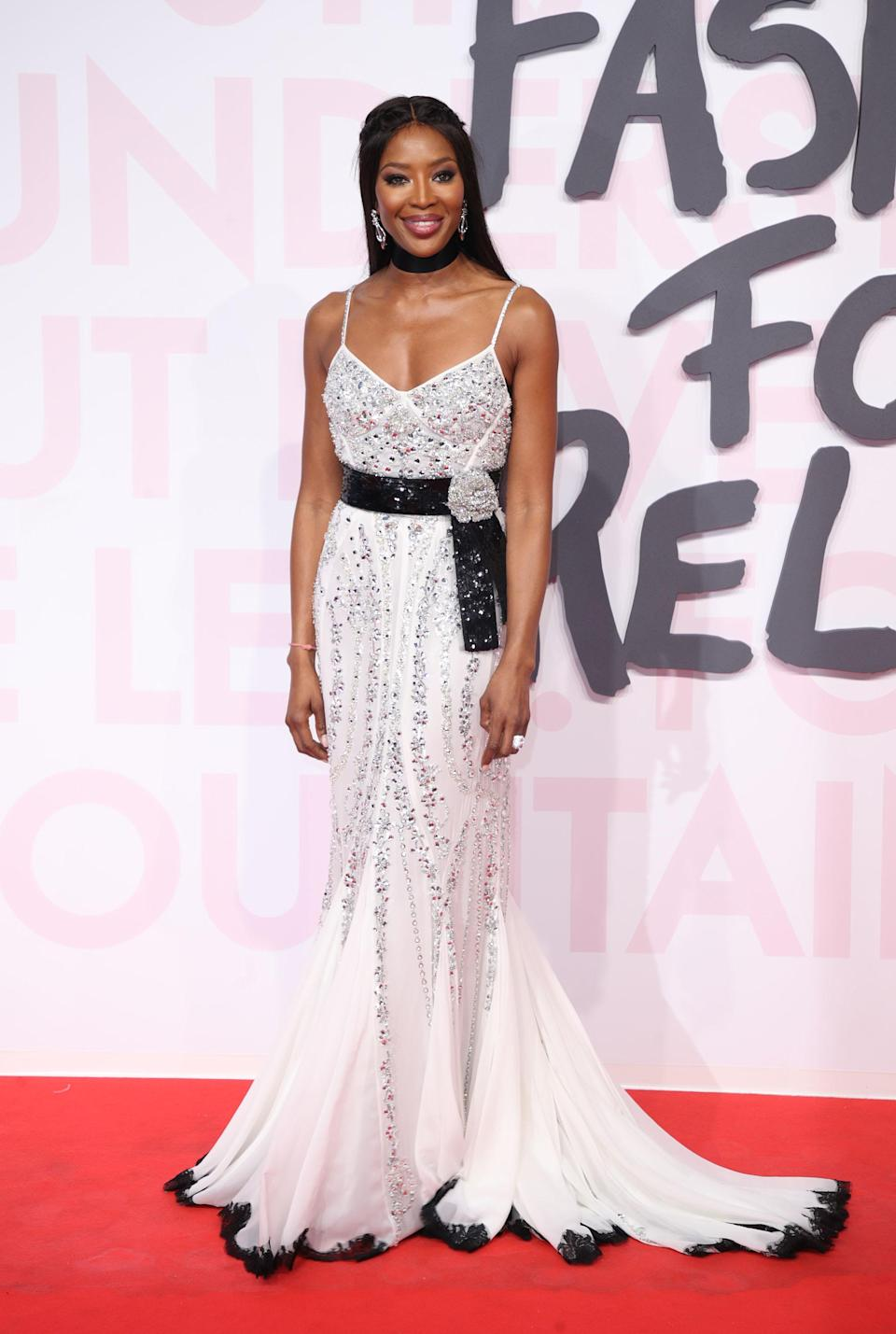 <p>The Fashion For Relief Gala host arrived on the red carpet wearing a silver embroidered gown with a black embroidered belt. [Photo: Getty] </p>