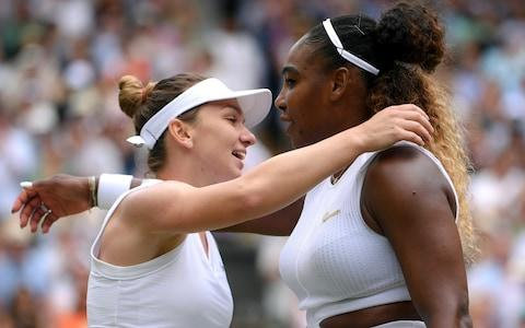 Simona Halep hugs United States' Serena Williams after defeating her in the women's singles final match on day twelve of the Wimbledon Tennis Championships - Credit: GETTY IMAGES
