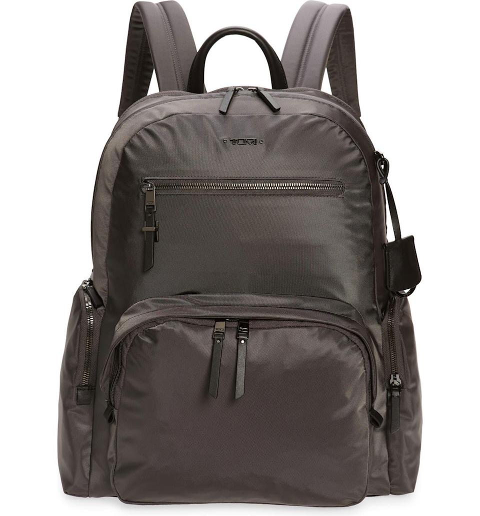 <p>Tumi is considered high-end in the luggage department, so it makes sense that the brand would offer stylish options that, at the same time, solve some major your dilemmas. After you stuff this nylon backpack with small toiletries, a pair of shoes, and a bulky sweatshirt, you can swing it over your shoulders and jet off to your next location.</p>