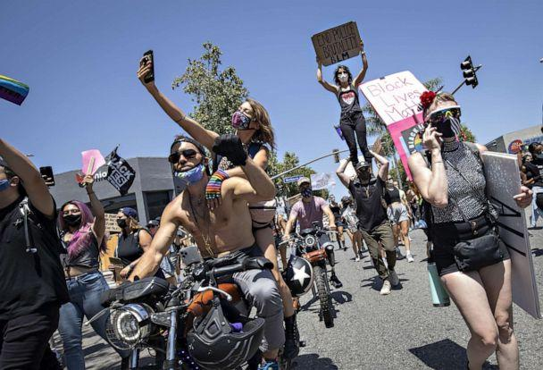 PHOTO: People march down Santa Monica Boulevard to demonstrate against police brutality after the death of George Floyd in Minnesota, in West Hollywood, Calif., June 14, 2020. (Christian Monterrosa/EPA via Shutterstock)