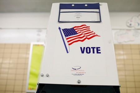 FILE PHOTO: Voting booth is seen as voting opens for the midterm election at P.S. 140 in Manhattan, New York