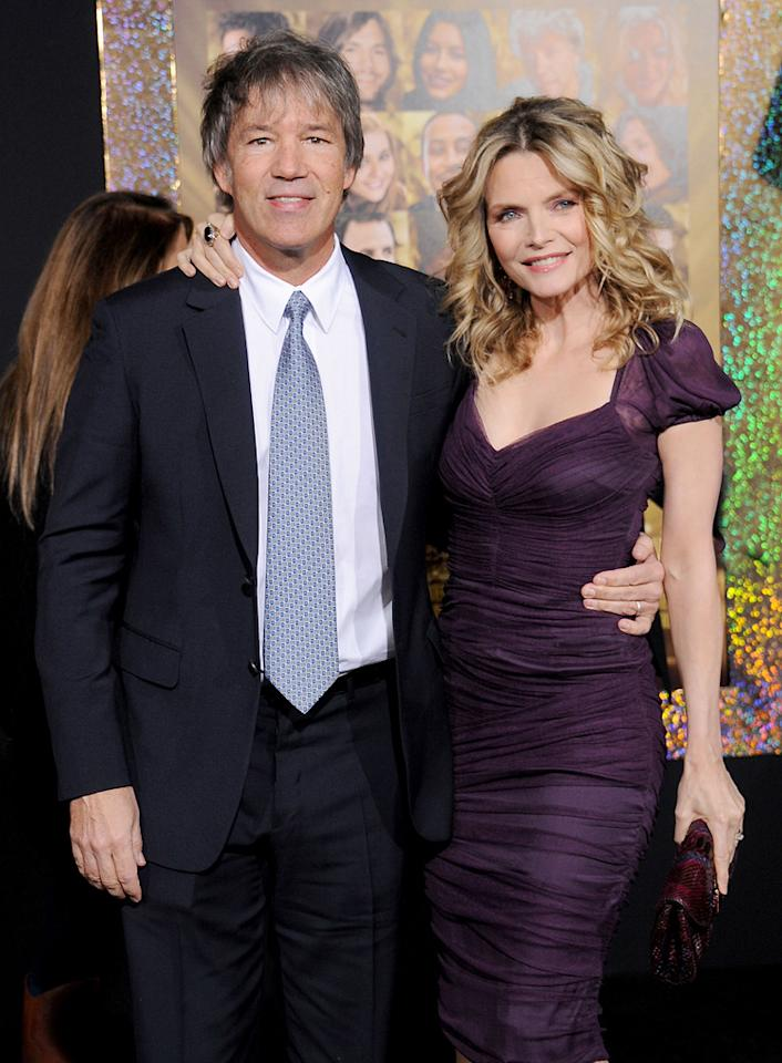 """<a href=""""http://movies.yahoo.com/movie/contributor/1808796862"""">David E. Kelly</a> and <a href=""""http://movies.yahoo.com/movie/contributor/1800016613"""">Michelle Pfeiffer</a> at the Los Angeles premiere of <a href=""""http://movies.yahoo.com/movie/1810219047/info"""">New Year's Eve</a> on December 5, 2011."""