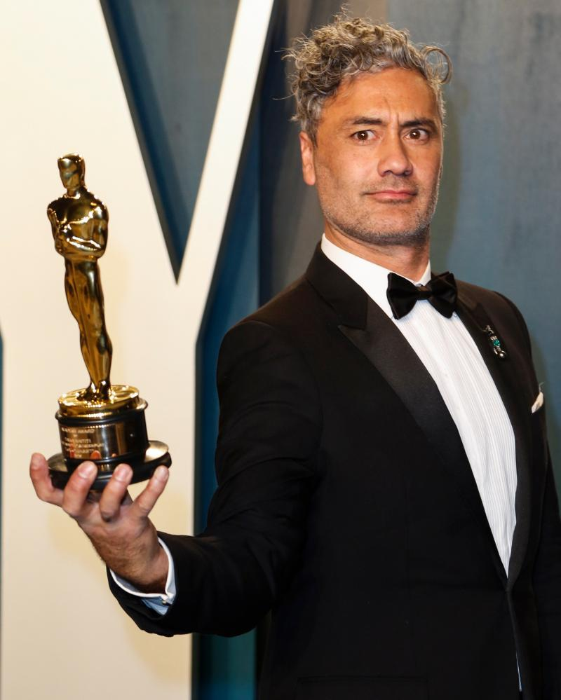 Taika Waititi with the best adapted screenplay Oscar statuette he won earlier this month.