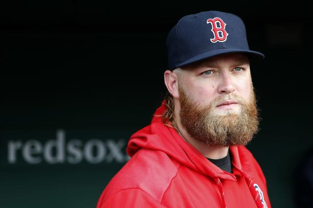 Boston Red Sox pitcher Andrew Cashner stands in the dugout before a baseball game against the Los Angeles Dodgers in Boston, Sunday, July 14, 2019. (AP Photo/Michael Dwyer)